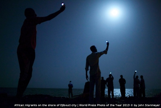 JEZT - African migrants on the shore of Djibouti city - World Press Photo of the year 2013 © by John Stanmeyer